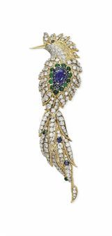 A SAPPHIRE, EMERALD AND DIAMOND 'BIRD OF PARADISE' BROOCH, BY VAN CLEEF & ARPELS The bird set throughout with brilliant-cut diamonds in textured yellow gold wirework surround, the body centering upon a pear-shaped sapphire, bordered with circular-cut sapphires and cabochon emeralds, (tail detachable), mounted in platinum and gold, 11.3 cm