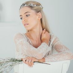 Boho pearl blossom circlet by Halo and Co Dreamily ethereal and elegantly handcrafted, this bohemian headpiece incorporates creamy clusters of pearls, sparkling blossoms and gleaming Swarovski crystal accents along a hand-wired circlet.