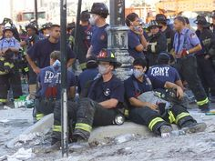 Firefighters gather near the World Trade Center site