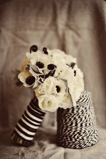 Anemones, white and black bouquet. Love the black centrex and ribbon detail
