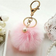 Birthstone of the month, June's pearl! Pick up one of our amazing pearl charm pom pom keyrings!