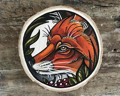 Wood slice with an original drawing of a fox