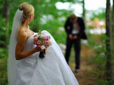 Groom makes his final adjustments Bride looks over adoringly as her groom makes his final adjustments.