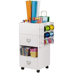Craft Storage Center on Wheels Empower your storytelling by keeping everything at your fingertips! Three drawers, two ribbon dowels and a deep embellishment holder with movable dividers let you keep all of your craft supplies organized and convenient.  (aff link)