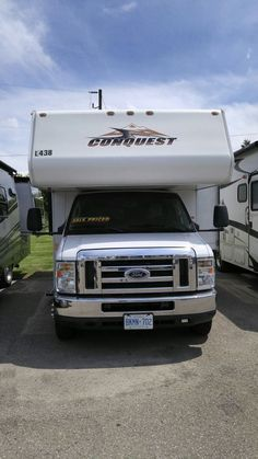 Full wall Slide Conquest, new living room vinyl flooring Class C Used Motorhome For Sale