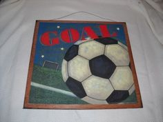 """Soccer Goal Boys Sports Bedroom Wooden Wall Art Sign by The Little Store Of Home Decor. $14.99. size 13x13. made in the USA. We've sealed this Soccer Goal print onto wood giving it a framed appearance. The background wood is painted a chocolate brown color with touches of black to accent the print. It measures approximately 13"""" squared by 1/4"""" thick (wood dimensions not including hanger). We've added a rusty tin wire for easy hanging. Lots more sports decor in our store"""