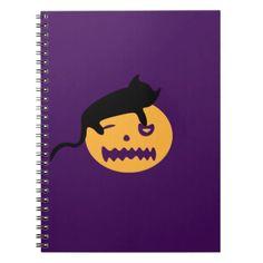 Sleeping cat on a pumpkin notebook - Halloween happyhalloween festival party holiday