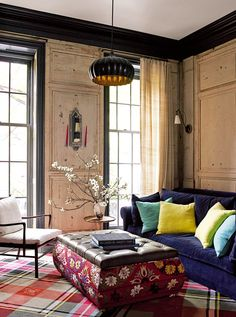 """Renovation: a Manhattan townhouse gutted and reimagined for family life: The den is lined with 17th-century wood panels bought in L'Isle sur la Sorgue, Provence. """"It didn't all fit quite right, so there are a couple of faked pieces,"""" says interior designer Poonam Khanna who, together with Annabel and her British interior-designer friend Sarah Russell, was responsible for the decorative choices."""