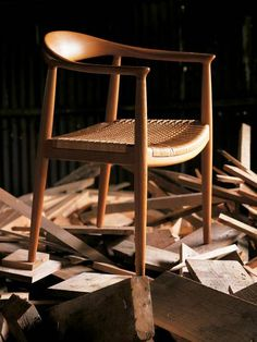 Round chair by Hans Wegner, handwoven cane seat, frame available in various woods, 1949, £600-800