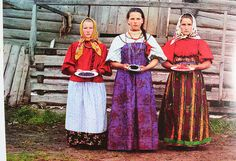 Ooh, Russian girls! I especially love that corset-type overdress in the center, and the broad half-sleeves. So colorful.