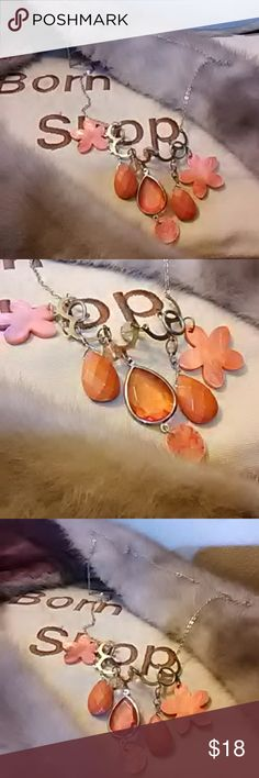 🔆Statement Bright Floral So Vtg Necklace Also came in the wholesale jewelry purchace I made at the estate sale that an elderly couple had recently. Super old. Many charms and dangles. 2 flowers,  2 tear opaque orange stones,  one clear 🍊 teardop charm in middle with iridescent dangling off centerpiece. 2 small circular clear pinkish orangish above centerpiece. On gold tone chain.  Goes on over head, no clasp for closure. So spring! Vintage Jewelry Necklaces