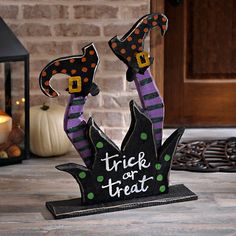 Give your outdoor Halloween space a witchy touch this year with our Trick or Treat Wooden Witch Legs! They're a great way to greet your trick-or-treaters! Dulceros Halloween, Halloween Wood Crafts, Outdoor Halloween, Halloween Projects, Holidays Halloween, Halloween Decorations, Art Plastique Halloween, Witch Legs, Harvest Decorations