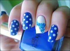 two coats of Pure Ice - French Kiss on all nails except on the ring finger.   I used for that two coats of Flormar M003 White. I stamped the dots from m79   Konad image plate with Jolfin Blanc. I stamped the bow from m59 plate with   Konad Special blue and then I applied a blue rhinestone in center.  I finished with Konad Special top coat.