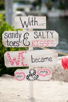 "Beach wedding sign idea - ""With sandy toes & salty kisses, we became Mr. & Mrs."" - colorful beach wedding sign {SO photography}"