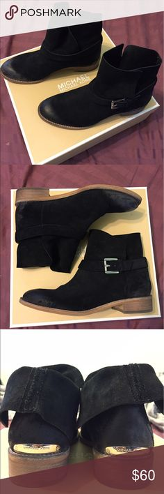 Only worn once or twice. Michael Kors women's size 7.5 Walton Ankle Boot in black suede. Can be worn with flaps folded down or left up. Very stylish boot. Toe and heal has distorted coloring as part of design. Very cute. KORS Michael Kors Shoes Ankle Boots & Booties