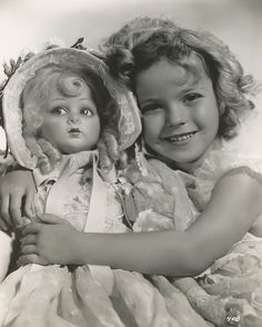 "Shirley Temple with Lenci doll, ""Pinkie"" from film, ""Bright Eyes."" See photos, ""Pinkie"" and more in traveling exhibits then in auction by Theriault's on July 14, 2015. http://www.theriaults.com"