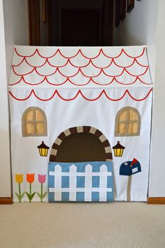 DIY Kids Hallway House Using Tension Rods. Use one or two curtain tension rods plus imagination. Really cute tutorial from the opening mailbox to the lantern inside from ikatbag here.