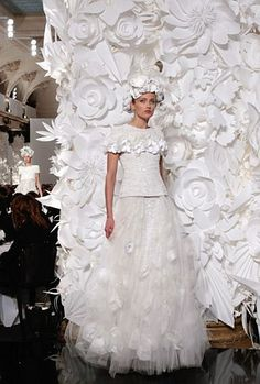 Beautiful dress, but...the huge, white paper flower backdrop is what I noticed first...