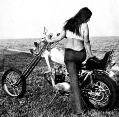 1970s motorcycle chopper and woman