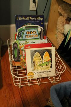 Another good use for a wire dish drying rack: corral kids' books.