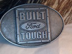 "Ford Trucks Belt Buckle, ""Built Ford Tough"" in Gunmetal Grey, Oval, for 1.5""…"