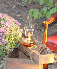 rusty horse shoes, oil lamps, and wood crates help create a warm rustic setting for wedding reception
