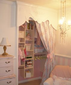 love how they changed a simple closet to a princess closet, just with a little fabric and custom wood valance