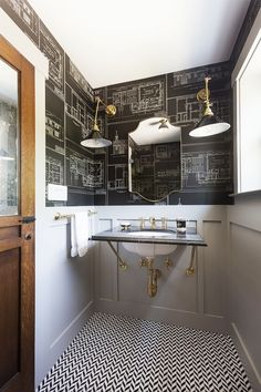 Bathroom with custom blue print wall paper and modern pendant lamps