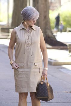 Safari Chic Fashion for Spring This sleeveless safari dress is perfect for spring. I added a camo bomber jacket for an extra layer of warmth and a pair of suede block heel booties. Visit Style at a Certain Age for more spring fashion ideas for women. Safari Chic, Casual Dresses, Fashion Dresses, Summer Dresses, Linen Dresses, Women's Casual, Maxi Dresses, Mode Bcbg, Camo Bomber Jacket