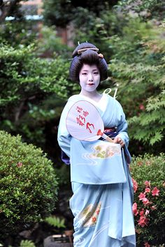 geiko Ayano with a summer fan
