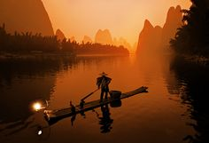 The Li River by Stuck in Customs, via Flickr // Great shot. Good reminder of using color. It doesn't always have to be true-to-life color in photographs. Sometimes consciously deciding to tint it one way or another can dramatically improve the effect the shot has on the viewer. The orange in this shot is so emotive.