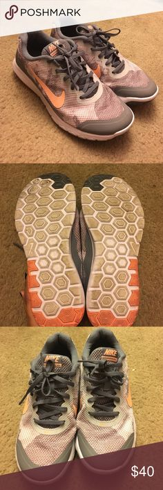 Women's Nike shoes Like new only worn very few times, I have wide feet so for these aren't a great fit other wise shoes are in great condition bit dirty from the few times I did use them, grey with peach color Nike Shoes Sneakers