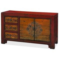 The design of this cabinet takes inspiration from traditional Tibetan floral art and features a distressed orange gradient. The asymmetrical design of this cabinet will be sure to garner much conversation. The double-door compartment on the right side, which has a removable shelf within, is adorned with intricate Tibetan floral motif.  While three additional drawers, featuring hand painted chrysanthemum motif, flank the left side of the cabinet.  The warm and vibrant color pallete of red and…
