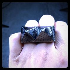 Authentic Black Scale 2 finger pyramid ring Authentic Black Scale 2 finger pyramid ring. Hardly worn. No scratches or dings. Doesn't have an actual size. It came in 2 sizes, this is the smaller one. No longer available for purchase anywhere. Bought this at the Black Scale flagship store in SF Black Scale Jewelry Rings