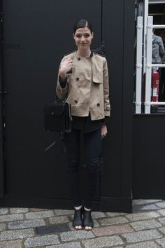 London Darling! 125 Snaps Straight From LFW: Elena Perminova matched her lipstick to her skirt and topped of the look with a sharp, cropped trench. : Classic up top, modern on bottom.