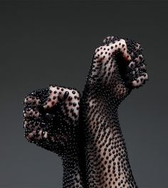 Shai Langen plays with latex and emulsions creating cell like droplets on the skin. He created textures by combining living matter and non-living matter forming intricate patterns and designs.