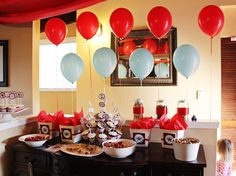 I like the way the food is set up with the balloons.