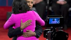 78. President Barack Obama embraces first lady Michelle Obama on stage after the second presidential debate, Oct. 16, 2012, in Hempstead, N.Y.    October 17, 2012