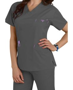 0966ec02f64 FLAWLESS FLEX AND FLAIRDetails matter in this breezy V-neck scrub top that  stretches with