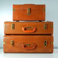 Stacking leather suitcases.