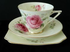 Doulton deco: June tea trio, V2192, c1940 (pattern). Gold gilt colourway - pink double rose and foliage with gold gilt highlights and trim.