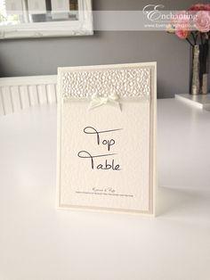 Ivory Wedding Stationery | Bespoke Design - Table Name Card | Featuring ivory pebble paper, bridal white satin ribbon and pretty bow embellishment | Luxury handmade wedding invitations and stationery #byenchanting