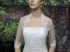 Sale  Ivory 3/4 sleeve bridal shrug lace bolero by alexbridal, $49.99... pretty and not too much lace to compete with dress
