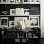 dining rooms - white black black wood dining table Jonathan Adler ceramic statues vases white Ikea lack floating shelves photo gallery black walls Wishbone Chair Bryant Chandelier