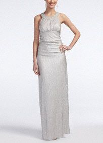 Give this sparkling and chic dress afierce attitude!  Features high neckline with eye-catching beaded detail.  Long soft foil jerseyruched bodice is figure flattering and gives you a flawless look.  Fully lined. Back zip. Imported polyester. Dry clean only.