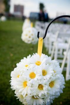 Pomanders on Shepherd's Hooks.. perfect for an outdoor wedding