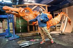 Costume designer Charles Baldwin with a dragon puppet.