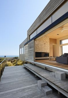 Modern Beach House on Fire Island. Expertly Hidden support Beams, that integrates Beautifully with the Native Shrubs.