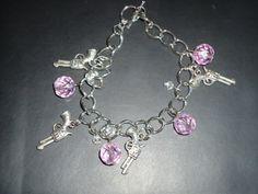 Pink & Gunny Charm Bracelet. $8.00, via Etsy.