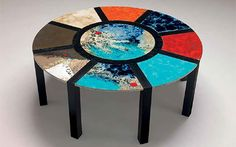 Portofino Lava Outdoor Table Collection   Hand crafted, painted lava tops   Welded aluminum or wood frame   Dozens of table top patterns   Made in Italy